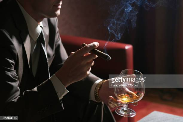 man with cigar and cocktail - the fan of cigars stock pictures, royalty-free photos & images