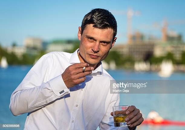 Man with cigarette and a glas of whiskey