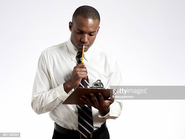 Man with clipboard and pencil
