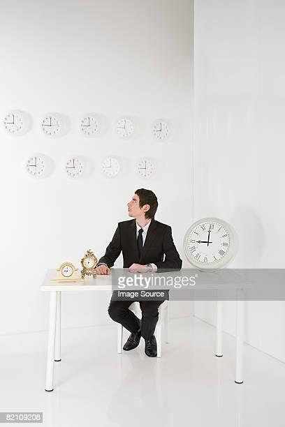 Man with clocks