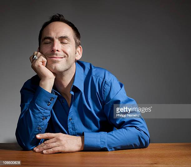 man with closed eyes smiling
