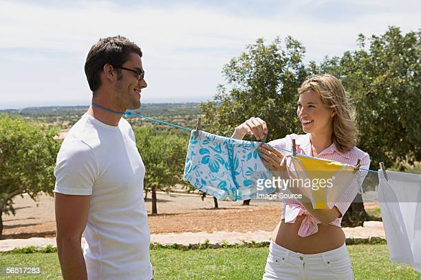man with clothes line tied round his neck - noose stock photos and pictures