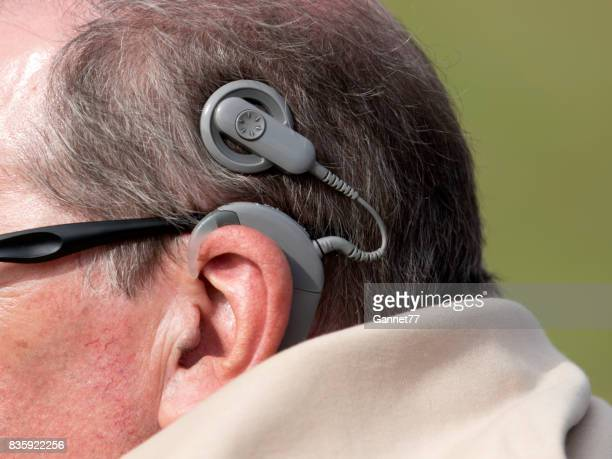 man with cochlear implant - assistive technology stock photos and pictures