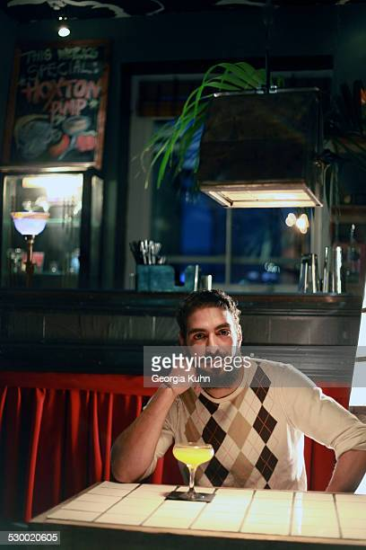 Man with cocktail at bar