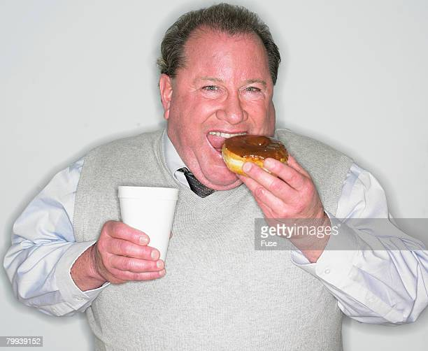 Man with Coffee and Doughnut