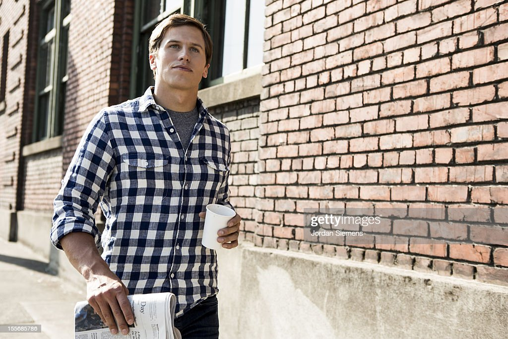 A man with coffee and the newspaper. : Foto stock