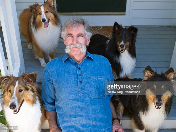 Man with collie's on porch