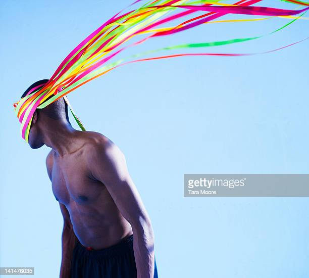 man with colored ribbons attached to head