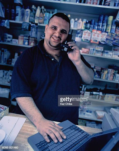 Man with Computer in Store