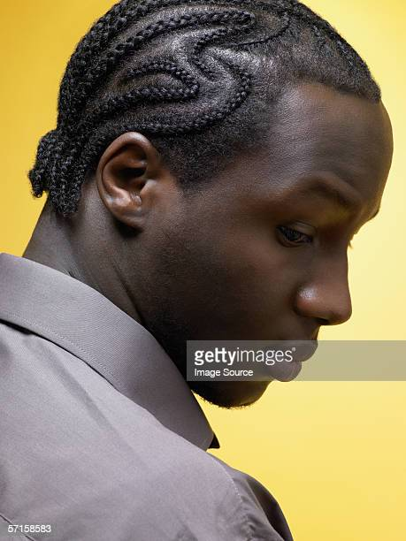 Man with cornrow hairstyle