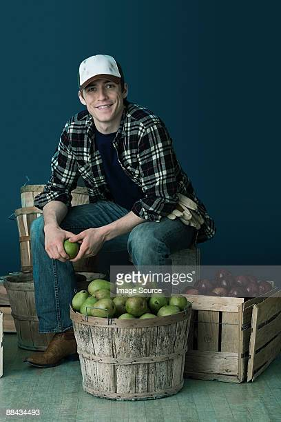 Man with crates of fruit