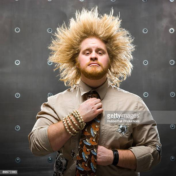 man with crazy hair fixing tie