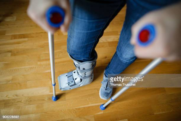 A man with crutches and an orthosis on his leg on January 15 2018 in Berlin Germany