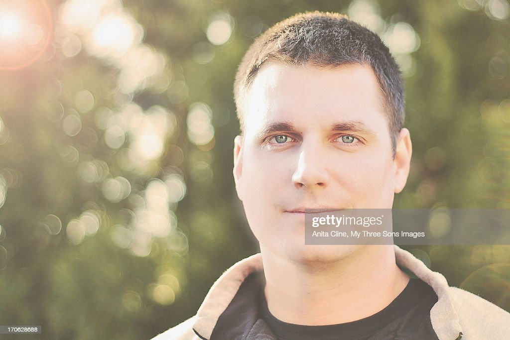 Man With Dark Hair And Stunning Blue Eyes Stock Photo Getty Images