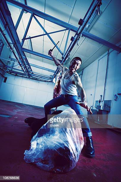 Man with Dead Body in Slaughterhouse