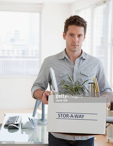 Man with Desk Items Packed in Box