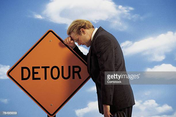 man with detour sign - detour sign stock photos and pictures