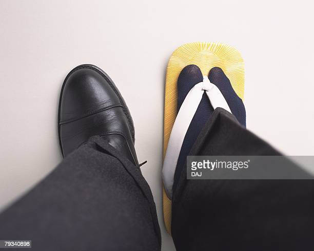 Man with differently dressed feet