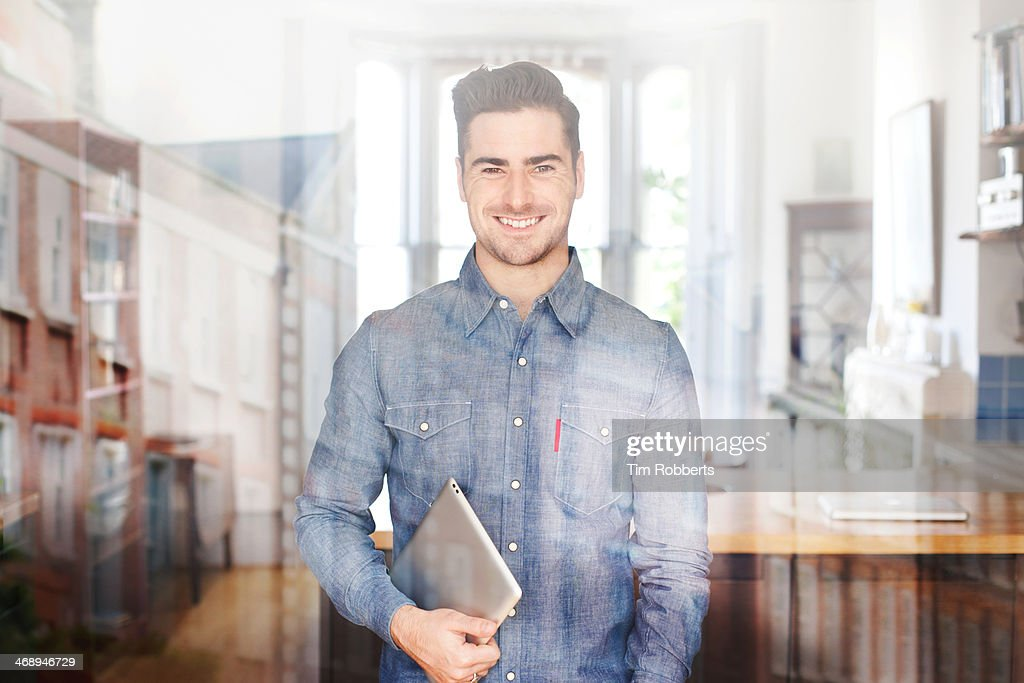 Man with digital tablet and reflections. : Stock Photo