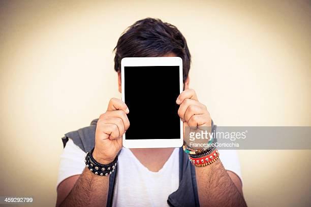 man with digital tablet - bedekken stockfoto's en -beelden