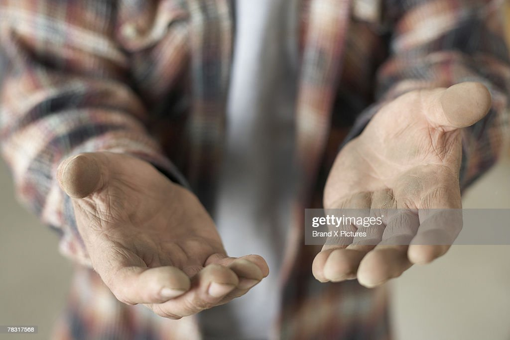 Man with dirty hands : Stock Photo