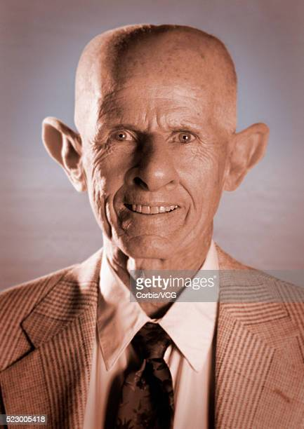 man with distorted features - ugly bald man stock photos and pictures