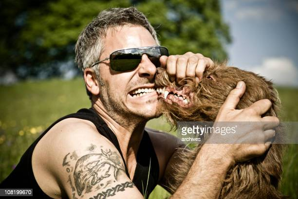 man with dog both snarling teeth and growling - molar stock pictures, royalty-free photos & images