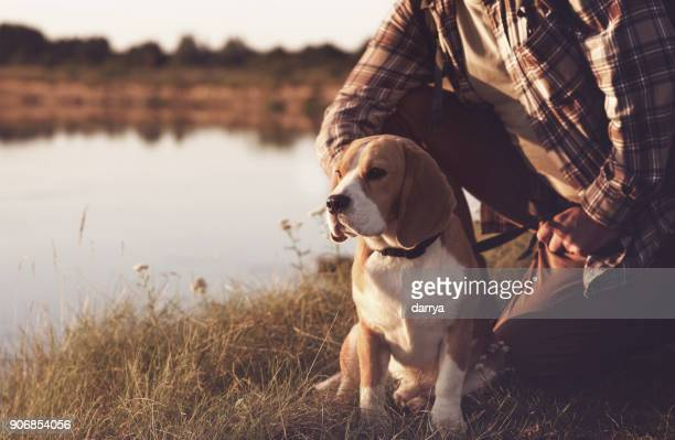man with dog enjoying nature - riverbank stock photos and pictures