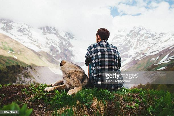 Man with dog in mountains