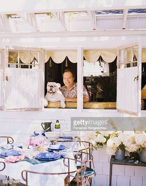 Man with Dog in Window by Patio