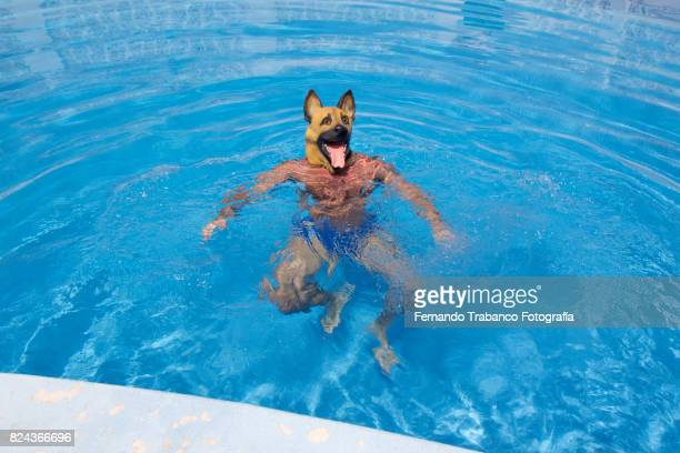 Man with dog mask in the pool