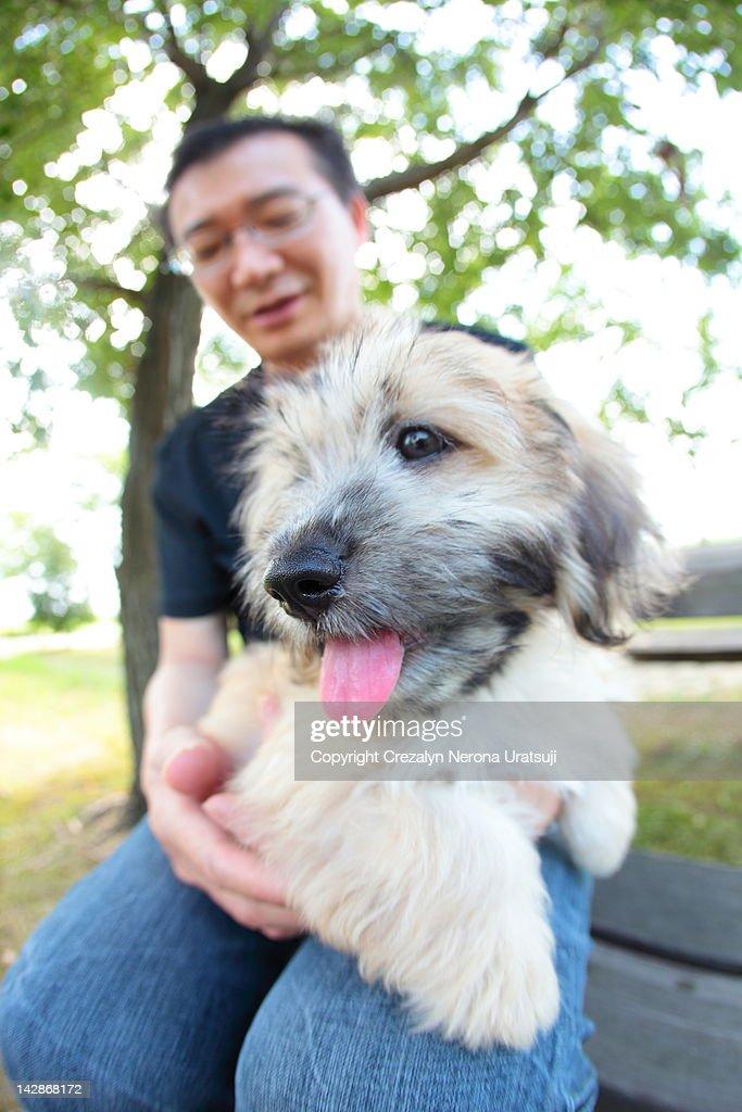 Man with dog : Stock Photo