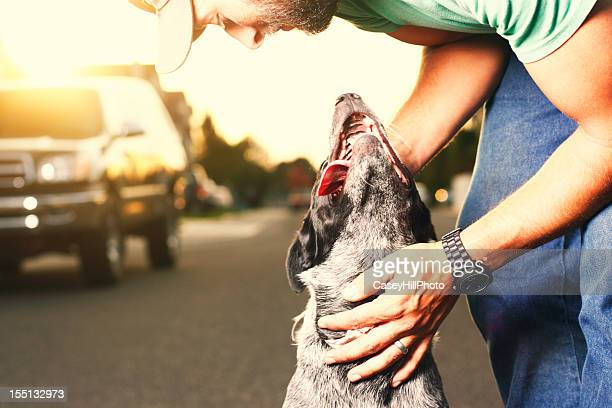 man with dog - australian cattle dog stock pictures, royalty-free photos & images