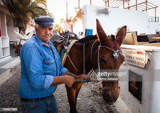 CONTENT] Man with donkey in Fira Santorini Greece