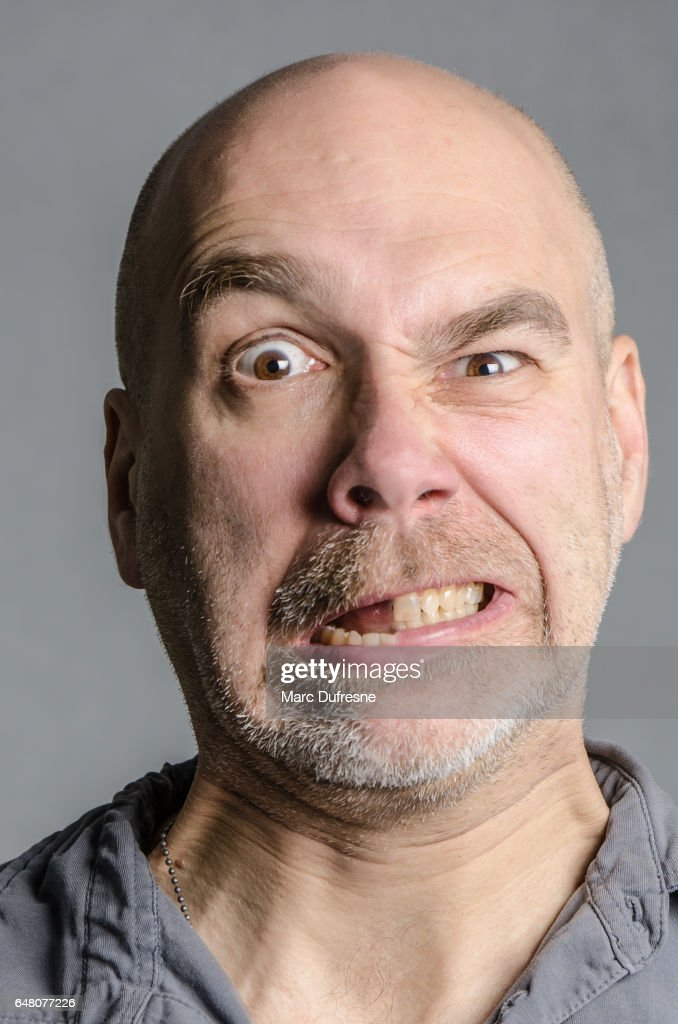 Man With Double Emotion Fear And Anger Stock Photo