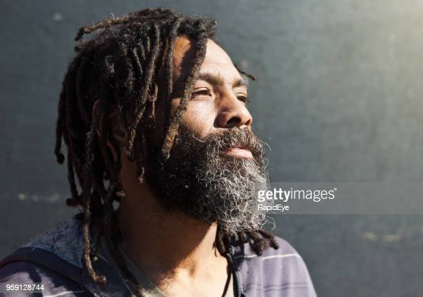 man with dreadlocks looks thoughtful - dreadlocks stock pictures, royalty-free photos & images