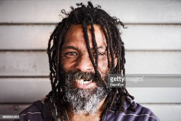 man with dreadlocks smiles - homeless person stock pictures, royalty-free photos & images