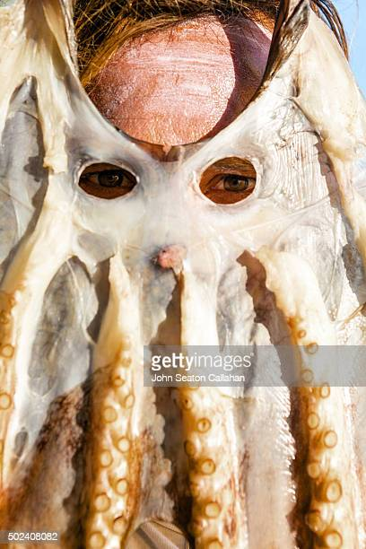 Man with drying octopus