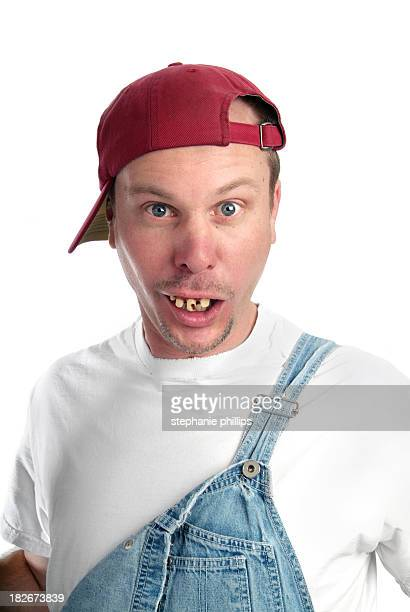 man with dumb expression and bad teeth wearing overalls - redneck stock photos and pictures