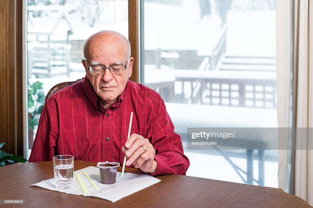 Man with dysphagia working to improve his swallowing : Stock Photo