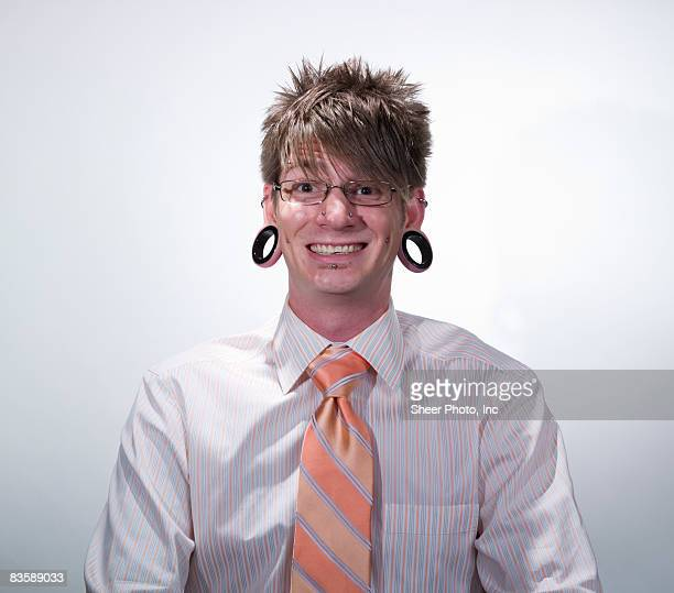 man with ear gauges and multiple piercings - solo un uomo foto e immagini stock