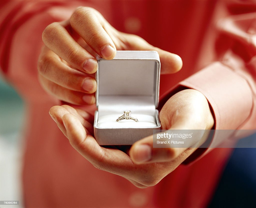 Man with engagement ring : Stock Photo