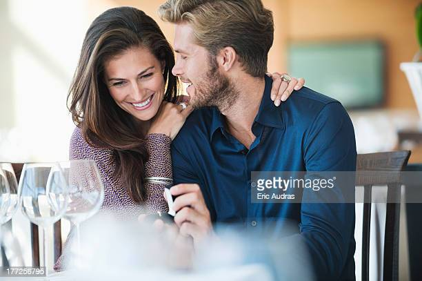 Man with engagement ring proposing his girlfriend in a restaurant