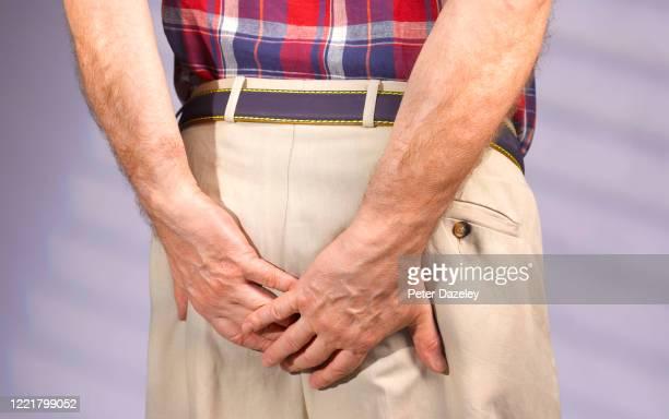 man with excessive flatulence and diahorrea - hemorroide fotografías e imágenes de stock