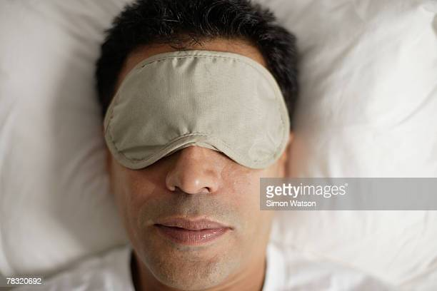 Man with eye mask