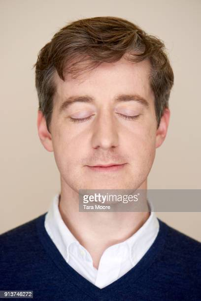 man with eyes closed