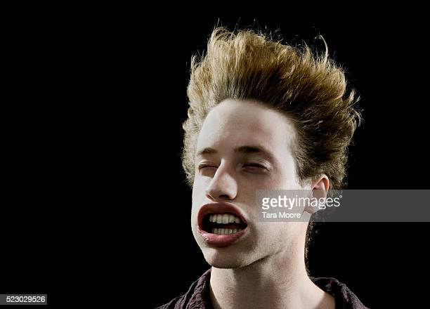 man with face being blown by powerful wind - wind stock pictures, royalty-free photos & images