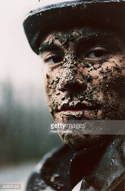 man with face covered in mud - mud stock pictures, royalty-free photos & images
