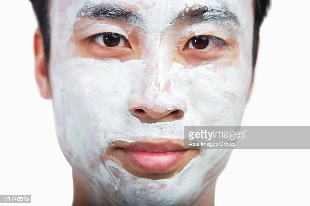 Man with face mask looking at camera