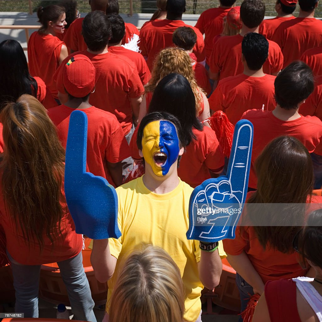 Man with Face Paint Cheering : Stock Photo
